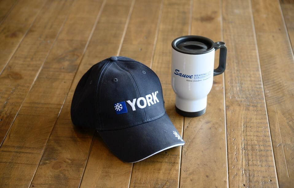 York baseball cap and Sauve travel mug
