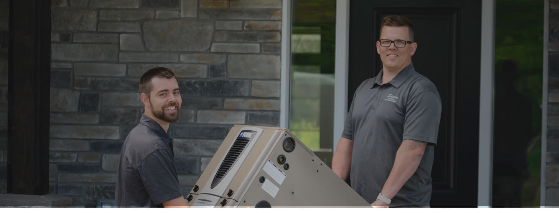 Devin Pettes and Jordan Brown HVAC experts installing a new furnace in an Ottawa home