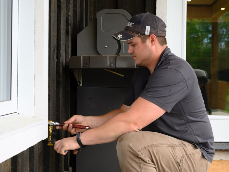 a Sauve Heating and Air Conditioning employee