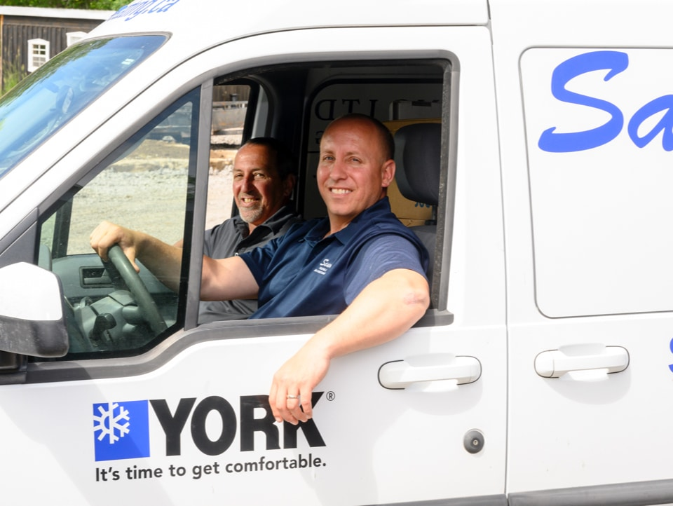 Ben and Don Sauve in a HVAC service truck